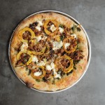 Roasted Delicata Squash Kale Pizza with sausage, caramelized onions and candied walnuts! Recipe on shutterbean.com
