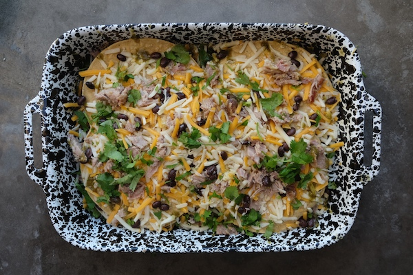 Weeknight meals are made EASY with this Pork Enchilada Lasagna. Find the recipe on Shutterbean.com