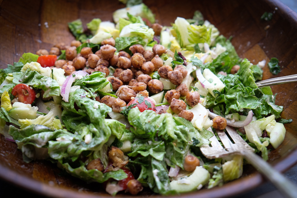 Chopped Salad with Spiced Chickpeas made with a lemon tahini dressing. Find the recipe on Shutterbean.com!