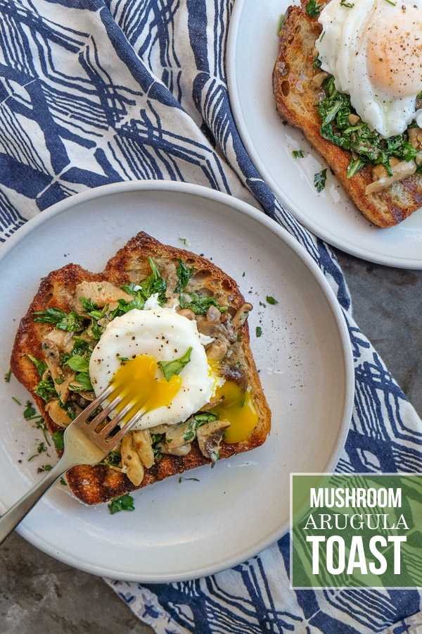 Creamy Mushroom Arugula Toast with Poached Eggs. Find the recipe on Shutterbean.com