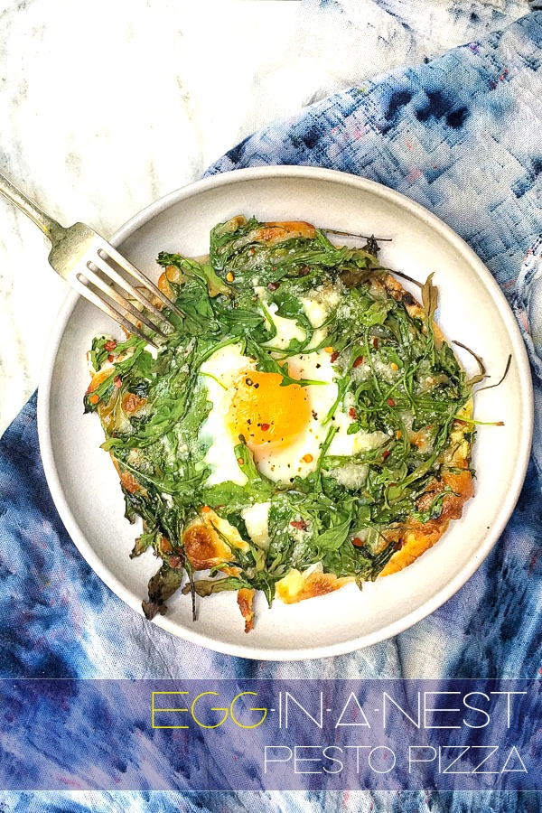 Try this Egg-In-A-Nest Pesto Pizza made with pita bread for a healthy breakfast. Recipe on Shutterbean.com!