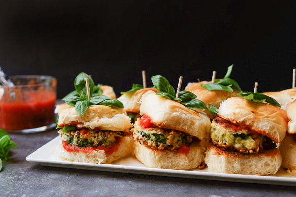 Zucchini Parmesan Sliders are a real crowd pleaser. Vegetarian too! Find the recipe on Shutterbean.com