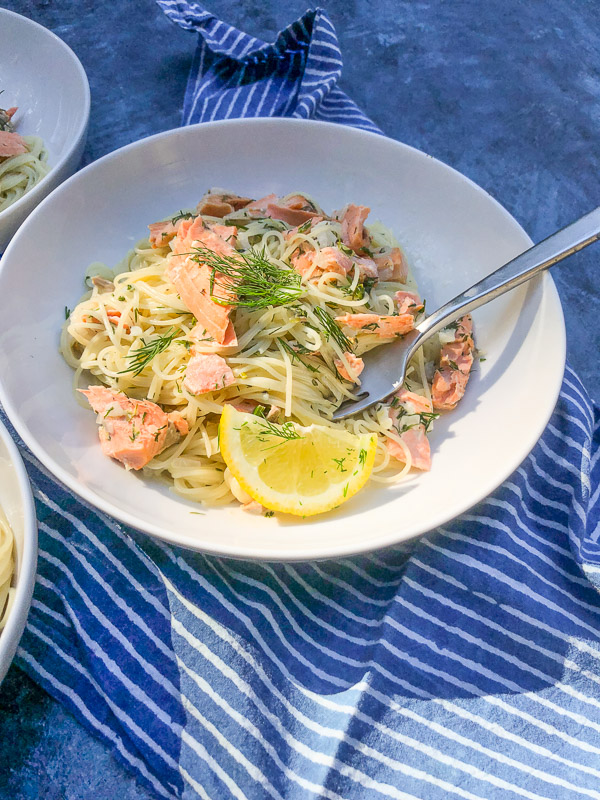 Lemon Dill Capellini with Salmon is a great light Summer dish. A great use for salmon leftovers. Find the recipe on Shutterbean.com
