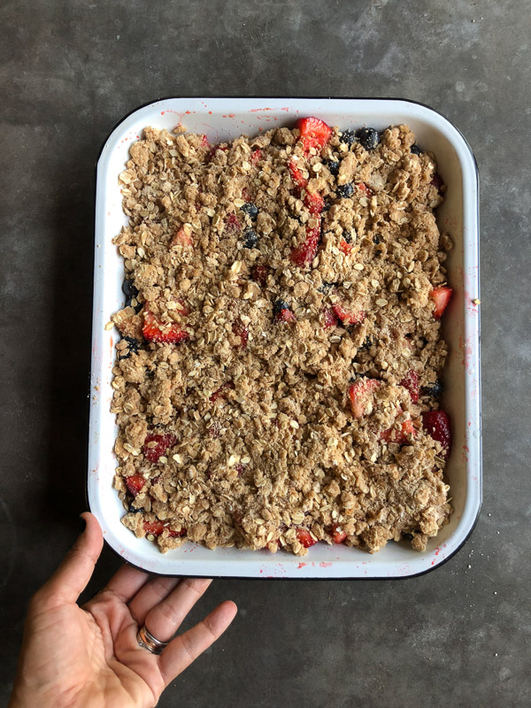 Simple Mixed Berry Crumble with whipped cream is a wonderful summer dessert. Find the recipe on Shutterbean.com!