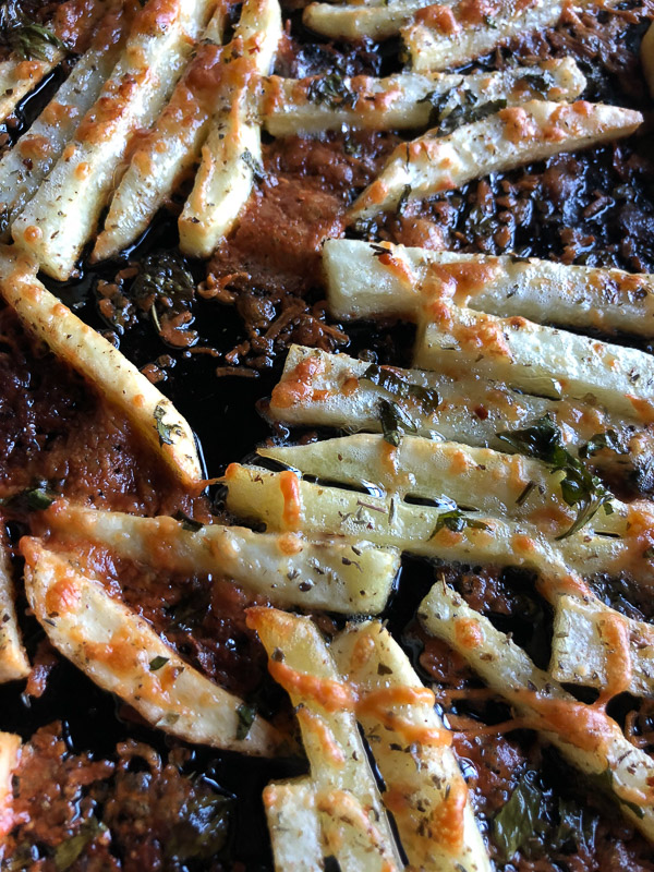 Want to impress dinner guests? Make these crispy Italian Fries! A combination of melted cheese and Italian herbs will level up your baked oven fry game. Recipe on Shutterbean.com!