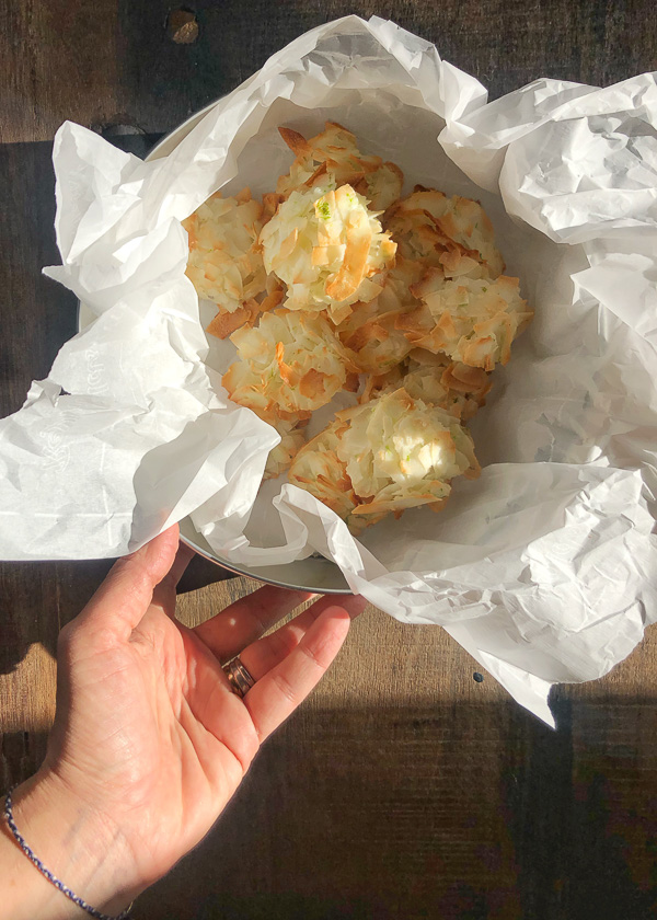 Coconut Lime Macaroons are light, chewy and crispy! Add them to your gluten free baking repertoire! Find the recipe on Shutterbean.com!