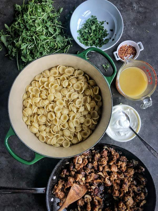 Creamy Mushroom Sausage Orecchiette is the ultimate comfort food. Make it for your guests! Find the recipe on Shutterbean.com