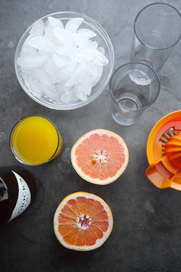 The Summer Breeze Cocktail is a delicious blend of fresh grapefruit juice, pineapple juice & gin. Find the recipe at Shutterbean.com