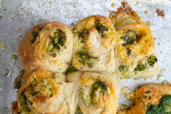 Transform store bought pizza dough into Broccoli Cheddar Rolls. It makes for a perfect weeknight dinner! Recipe on Shutterbean.com