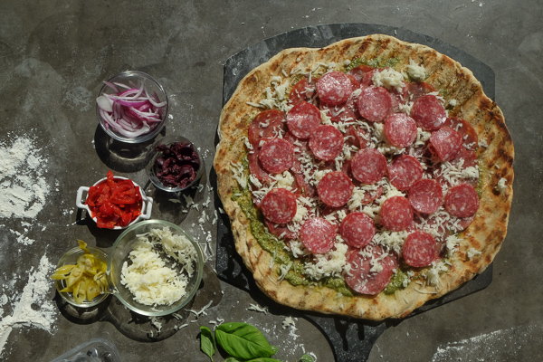 Turn the classic muffuletta sandwich into a pizza with this Muffuletta Pizza. Find the recipe on Shutterbean.com!