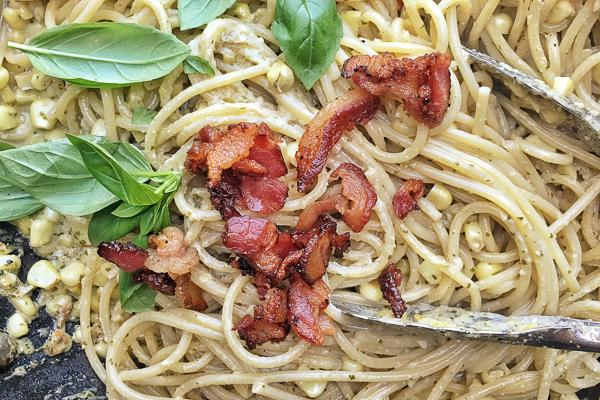 Creamy Corn Basil Pasta studded with crispy bacon. Find the recipe on Shutterbean.com