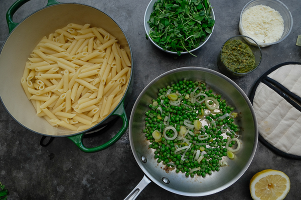 Celebrate Spring goodness with a bowl of Penne with Pistachio Mint Pesto. Find the recipe on Shutterbean.com