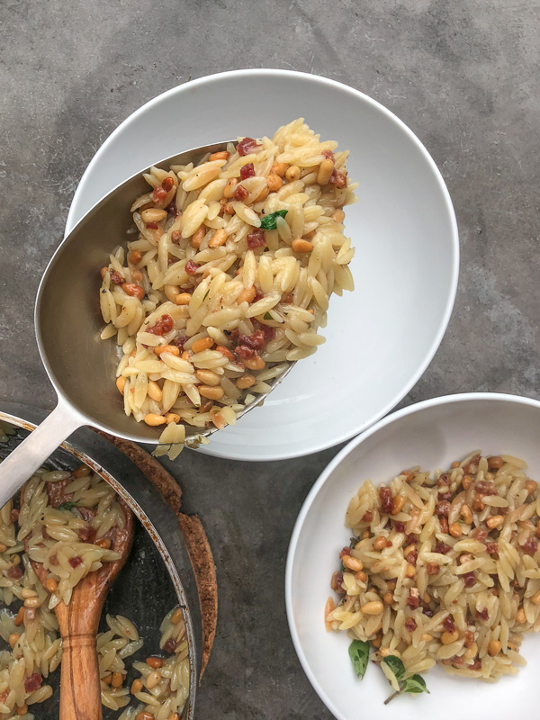 Orzo with Pancetta and Pine Nuts - a delicious/easy to prepare dinner! Find the recipe on Shutterbean.com