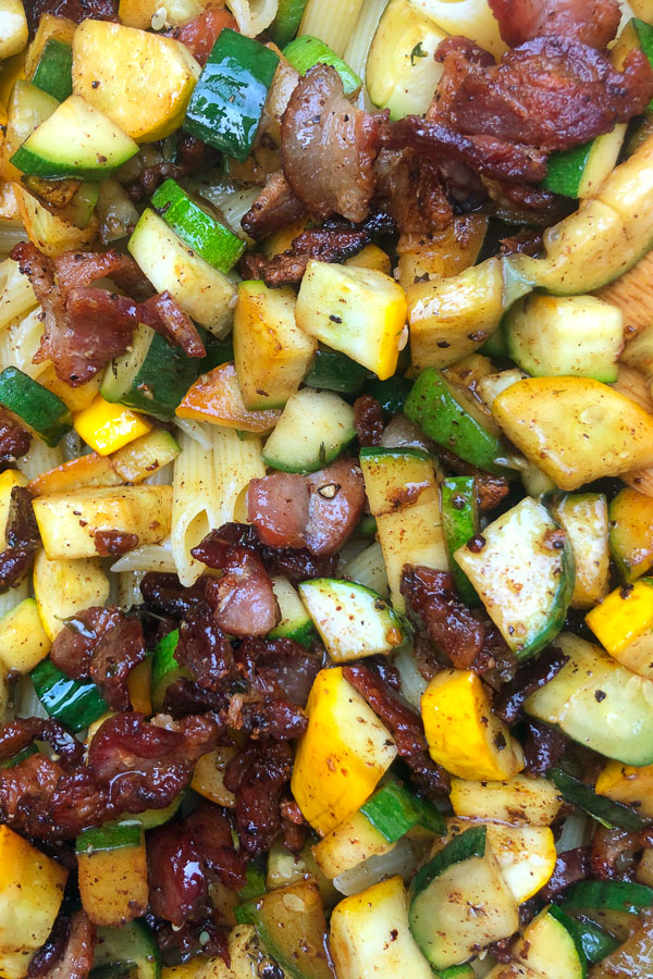 Creamy Zucchini Carbonara made with fresh zucchini and crispy bacon! Find the recipe on Shutterbean.com
