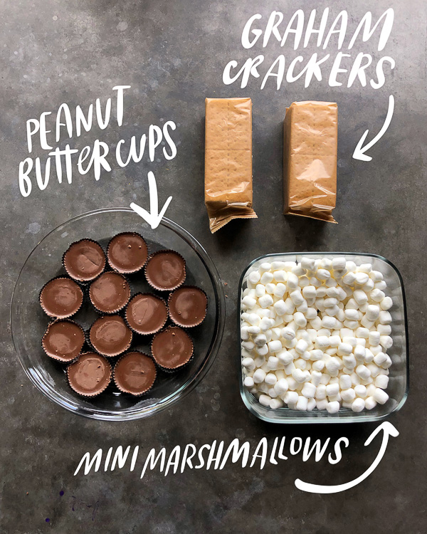 Win at dessert with this SIMPLE Peanut Butter S'Mores Dip made with peanut butter cups. Recipe on Shutterbean.com!